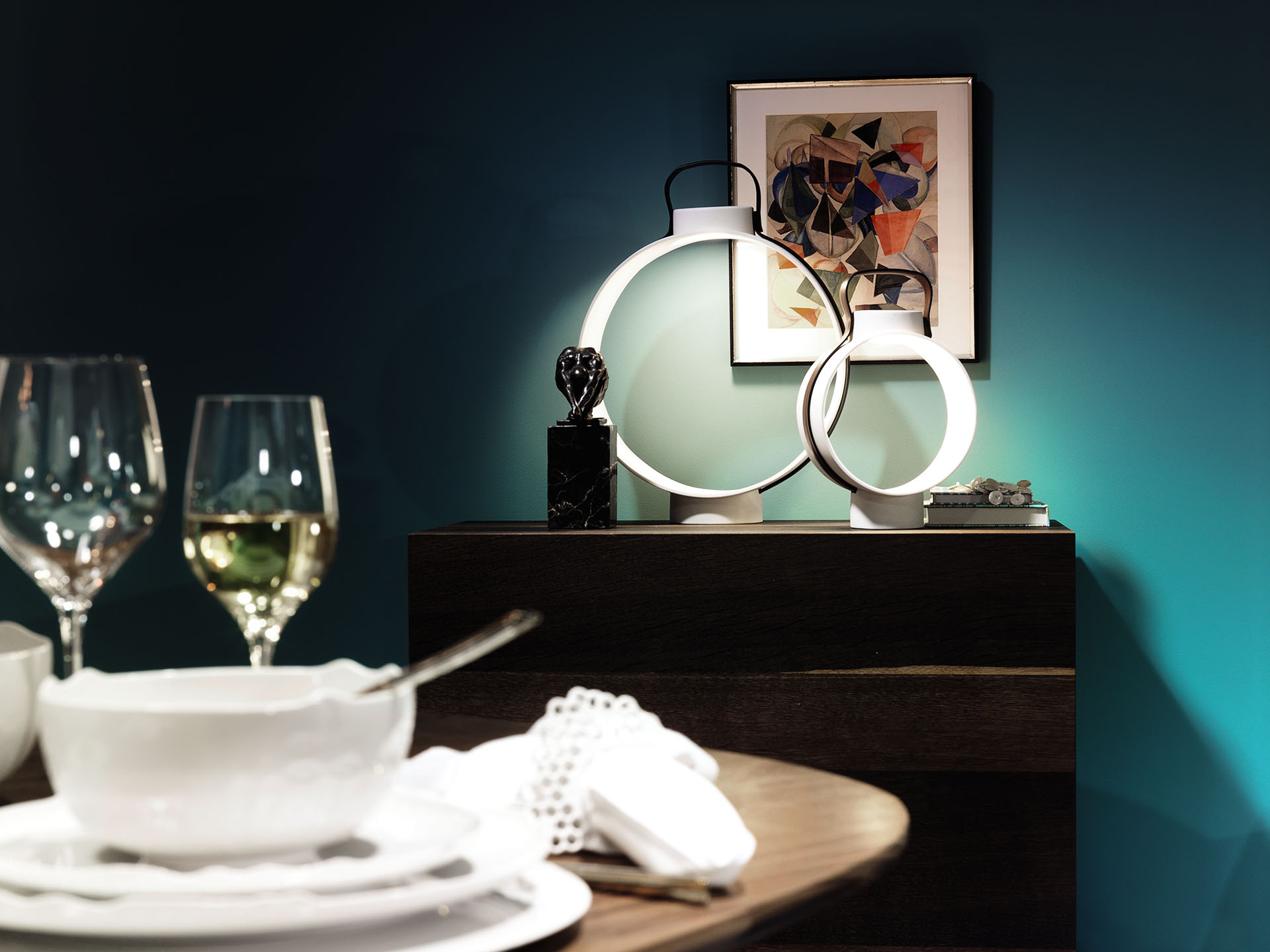 Rosenthal - Nightingale, a table lamp with a matte porcelain body and a leather ribbon that recalls an ancient lantern